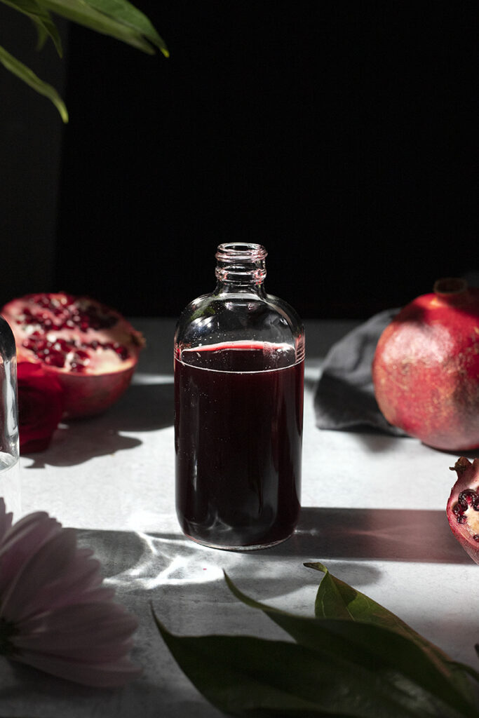 an apothecary bottle filled with dark red syrup