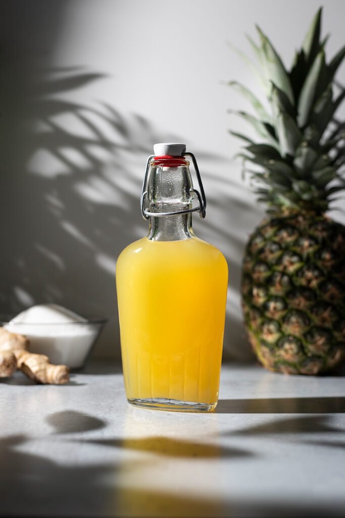swing top bottle of yellow pineapple ginger syrup.